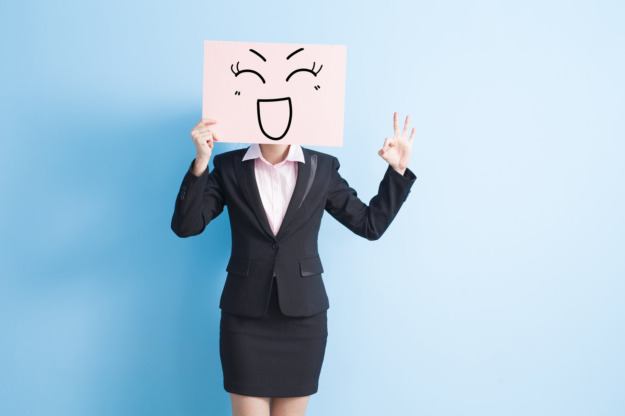 businesswoman with fake smile